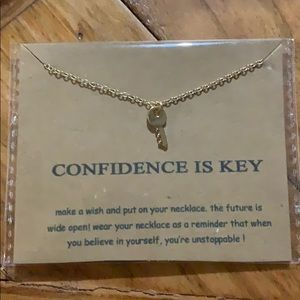 """Confidence is key"" gold dipped key necklace"